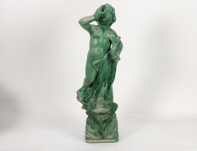 antique green fountain boy